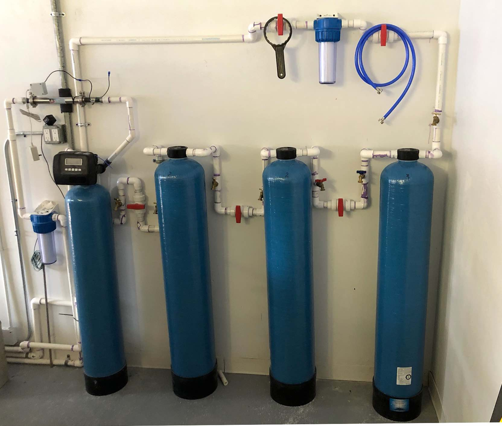 Fluoride removing whole-house filter system